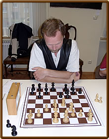 Claes Løfgren is concentrating on his 9th move