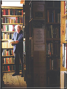 Jean Mennerat in his library